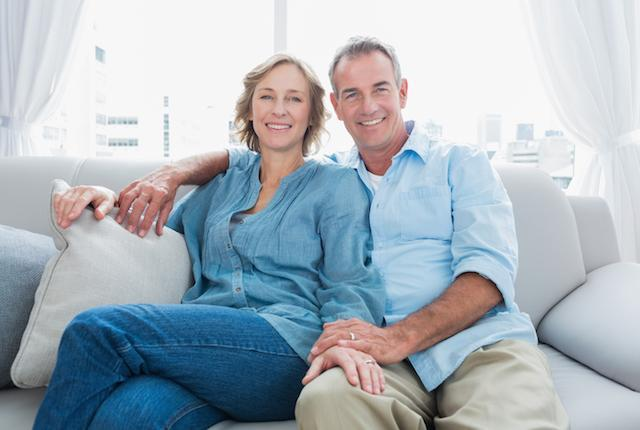 Couple sitting on couch | Dentist Fontana CA