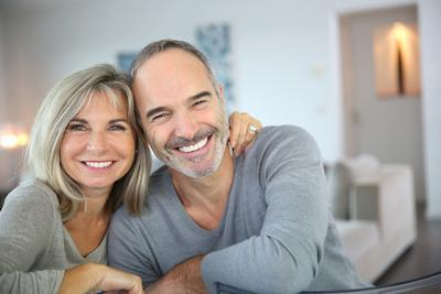smiling couple in living room | Dentist Fontana CA
