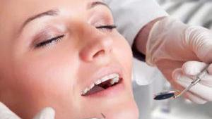 Woman getting dental exam | Sedation Dentistry in Fontana