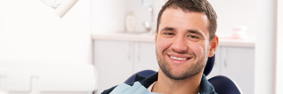 Man smiling in dental chair | sedation dentistry fontana ca